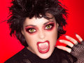 Lovely gothic girl vampire makeup caricature beautiful of screaming with fancy wolf lenses and big fangs Stock Photo