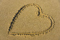 Lovely heart in sand at the beach
