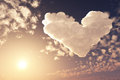 Lovely heart in sunset sky cloud romantic background styled from cloud d illustration Stock Photos