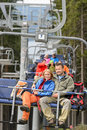 Lovely hiker couple sitting together on chairlift Royalty Free Stock Image