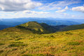 Lovely hillsides and sky picturesque landscape bright summer colors mood Stock Photography