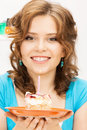 Lovely housewife with cake and candle bright picture of Stock Photos