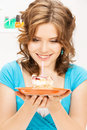 Lovely housewife with cake and candle bright picture of Royalty Free Stock Image