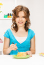 Lovely housewife at the kitchen with sweets bright picture of Stock Photography