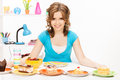 Lovely housewife at the kitchen with sweets bright picture of Stock Photo