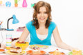 Lovely housewife at the kitchen with sweets bright picture of Royalty Free Stock Photo