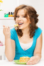 Lovely housewife at the kitchen with sweets bright picture of Royalty Free Stock Photos