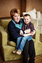 Lovely little boy with his grandmother having fun and happy moments together at home Stock Photography