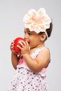 Lovely little girl biting an apple Royalty Free Stock Photography