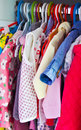Lovely little girl dresses hanged in the closet Royalty Free Stock Photo