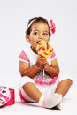 Lovely little girl eating a big lollipop Royalty Free Stock Photography