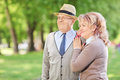 Lovely mature couple standing in park and looking the distance Royalty Free Stock Images