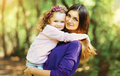 Lovely mother and child walking in the park Royalty Free Stock Photo