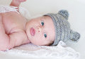 Lovely newborn age of weeks in gray knitted hat portrait Royalty Free Stock Photos