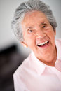 Lovely old woman laughing portrait of a Royalty Free Stock Photo