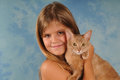 Lovely portrait of girl with kitten somali looking at camera Royalty Free Stock Image