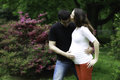 Lovely pregnant couple in nature happy Stock Image