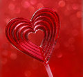 Lovely red lollipop in heart shape. Symbol of sweet love Stock Images
