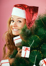 Lovely santa girl decorating christmas tree Stock Image