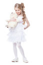 Lovely smiling girl with white teddy bear Royalty Free Stock Images