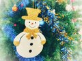 Lovely snowman, Christmas ornaments on Christmas tree. Royalty Free Stock Photo