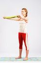 Lovely sporty woman doing stretching exercise Stock Photos