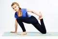 Lovely sporty woman doing stretching exercise Royalty Free Stock Photography