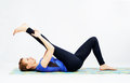 Lovely sporty woman doing stretching exercise Stock Image