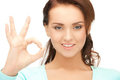 Lovely teenage girl showing ok sign