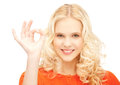 Lovely teenage girl showing ok sign bright picture of Stock Image