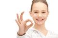 Lovely teenage girl showing ok sign