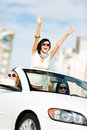Lovely teenager with her hands up in the cabriolet Royalty Free Stock Image
