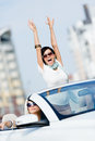 Lovely teenager with her hands up in the car friends girls drive somewhere on vacation Royalty Free Stock Photography