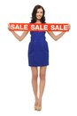 Lovely woman in blue dress with sale sign picture of Royalty Free Stock Photos