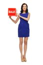 Lovely woman in blue dress with sale sign picture of Royalty Free Stock Images