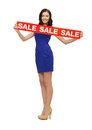 Lovely woman in blue dress with sale sign picture of Stock Photos