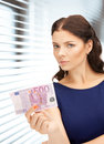 Lovely woman with euro cash money Royalty Free Stock Image