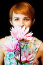 Lovely woman in floral dress holding flowers Royalty Free Stock Photo