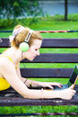Lovely woman having rest in the park with laptop young Royalty Free Stock Image