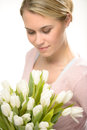 Lovely woman looking down white tulip flowers Royalty Free Stock Photo