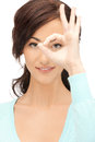 Lovely woman looking through hole from fingers Royalty Free Stock Photo