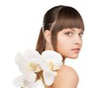 Lovely woman with orchid flower bright picture of Royalty Free Stock Images