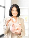 Lovely woman with piggy bank and money picture of Stock Photo