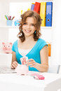 Lovely woman with piggy bank and money picture of Stock Image