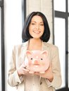 Lovely woman with piggy bank picture of Royalty Free Stock Photography