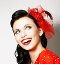 Lovely woman with red bow enjoying pleasure Royalty Free Stock Photo