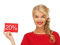 Lovely woman in red dress with discount card picture of Royalty Free Stock Images