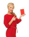 Lovely woman in red dress with note card picture of Stock Photo