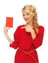 Lovely woman in red dress with note card picture of Royalty Free Stock Photography