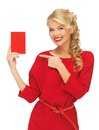 Lovely woman in red dress with note card picture of Royalty Free Stock Photos